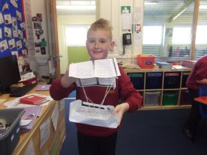 Connor is over the moon with his parachute.